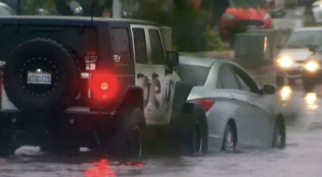 CHAMPION DRIVER USES JEEP TO RESCUE FLOODED CARS